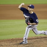 Milwaukee Brewers' Zach Davies delivers a pitch during the fifth inning against the Miami Marlins on Monday in Miami.