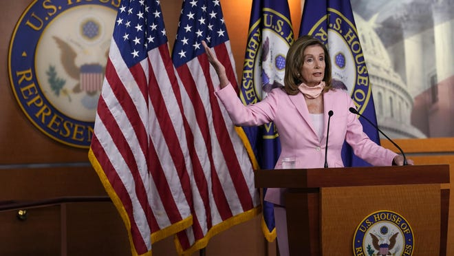 House Speaker Nancy Pelosi talks during a news conference on Capitol Hill in Washington, D.C., on Saturday, before a rare Saturday House session to pass legislation to halt changes in the Postal Service and provide $25 billion in emergency funds.
