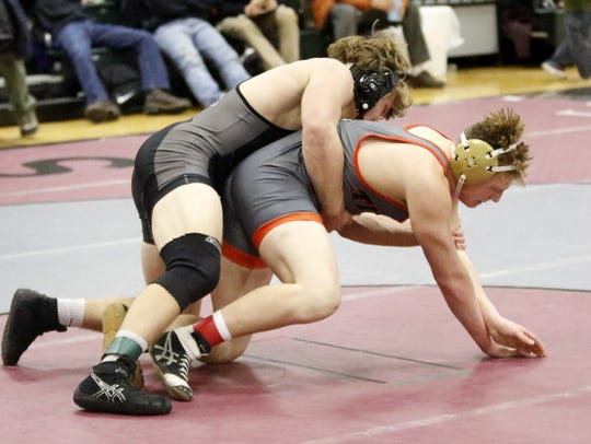Charlie Mahon, top, of Elmira wrestles Union-Endicott's Logan Shoemaker in the 170-pound championship match last year at the Elmira Christmas Tournament. Mahon won by pin.