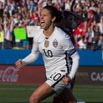 Carli Lloyd celebrates her goal against Mexico during