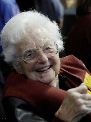 This March 22, 2018 file photo shows Sister Jean Dolores Schmidt sitting with other Loyola-Chicago fans during the first half of a regional semifinal NCAA college basketball game against Nevada in Atlanta. Sister Jean is depicted in a bobblehead and sales of the figurine have soared to the heavens. She has become a celebrity during the NCAA men's basketball tournament. As a result, the National Bobblehead Hall of Fame and Museum, in conjunction with Loyola University, last week unveiled a limited edition bobblehead. Phil Sklar with the soon-to-be-open museum in Milwaukee says within 24 hours, the bobblehead became the institution's top seller of all time.