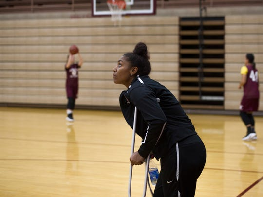 Alisha Owens watches the last shoot-around of the season  at Henderson County High School's gymnasium from the sidelines Wednesday morning. The Lady Colonels were heading to state tournament in about an hour and Owens was nursing an injured knee.