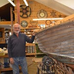 Bill Moon in the nautically themed workshop he built behind his home, where he is restoring a 1937 Lyman.