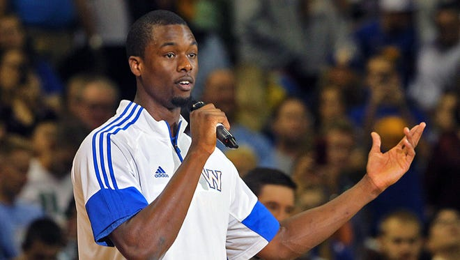 Golden State Warriors' Harrison Barnes addressed the crowd as he thanked them for attending NBA preseason game against the Denver Nuggets at Wells Fargo Arena in Des Moines on Thursday night Oct. 16, 2014.