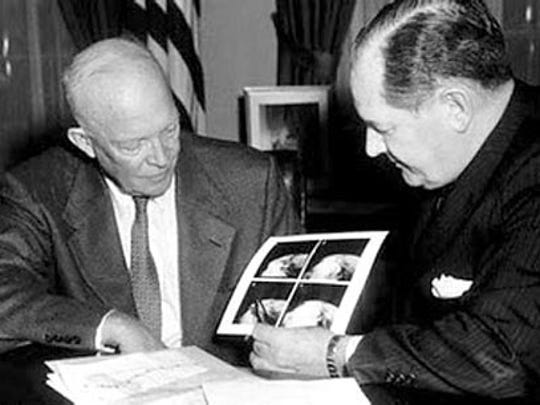 In the Oval Office at the White House in April 1960, President Dwight D. Eisenhower has a look at still images processed from television pictures from the TIROS 1 satellite that were received a few hours earlier at a ground station at Camp Evans in Wall Township. The photos represented frames from the first moving pictures ever taken of the Earth.