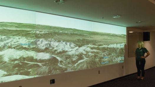 The Google Liquid Galaxy installation in the William Morgan Library at Colorado State University presents an immersive experience through laser projection technology.