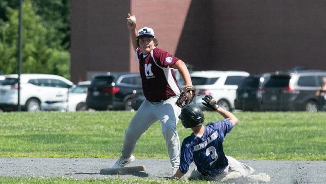 Millbury's Cam Ayotte gets a force out on Holden's Nick Burque.