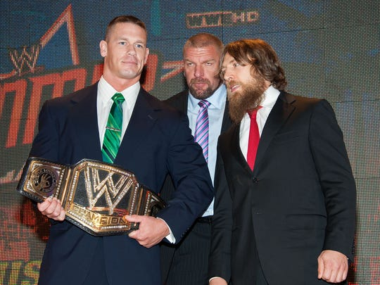 """John Cena, Paul """"Triple H"""" Levesque and Daniel Bryan attend a WWE SummerSlam Press Conference at Beverly Hills Hotel in this Aug. 13, 2013 file photo in Beverly Hills, California."""