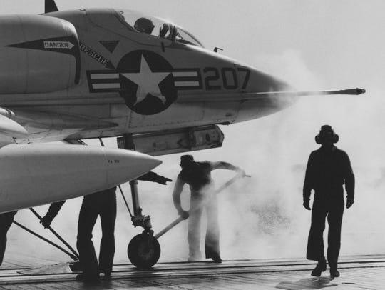 An A4D Skyhawk moves into launch position on USS Hancock,