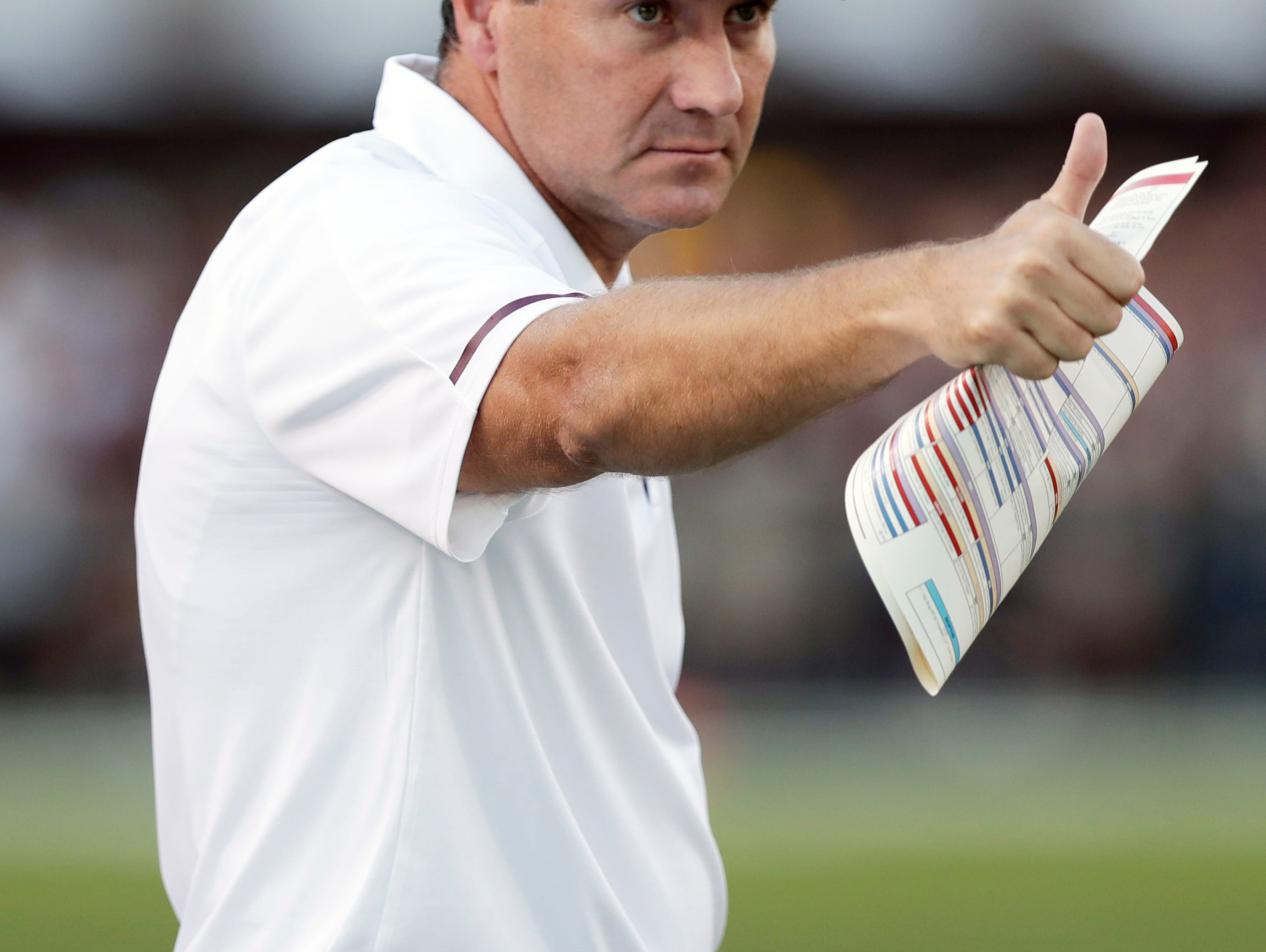 Mississippi State head coach Dan Mullen gestures toward the officials after a favorable call during the first half of an NCAA college football game against LSU in Starkville, Miss., Saturday, Sept. 16, 2017. (AP Photo/Rogelio V. Solis)