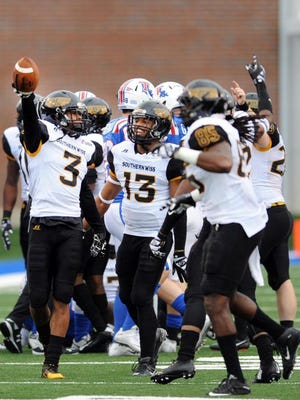 Southern Miss players, left to right, Cornell Armstrong, Picasso Nelson Jr. and JaBoree Poole celebrate after recovering a fumble  against Louisiana Tech.