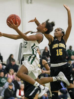 East Brunswick's Shanelle Colmon (22) goes up for a shot defended by Piscataway's Kendrea Williams (15) on Feb. 9 at East Brunswick.