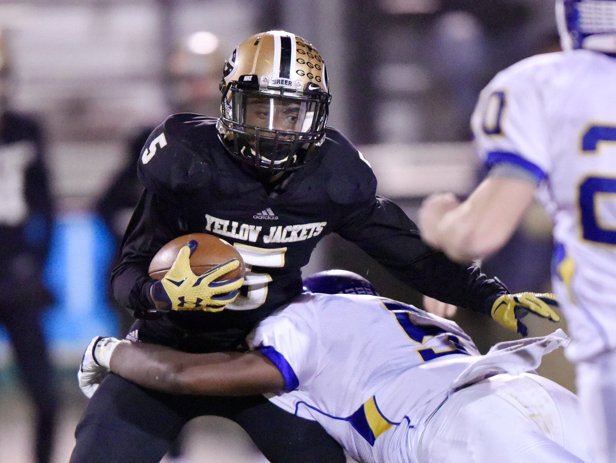 Greer's Troy Pride (5) is stopped by a Travelers Rest defender.