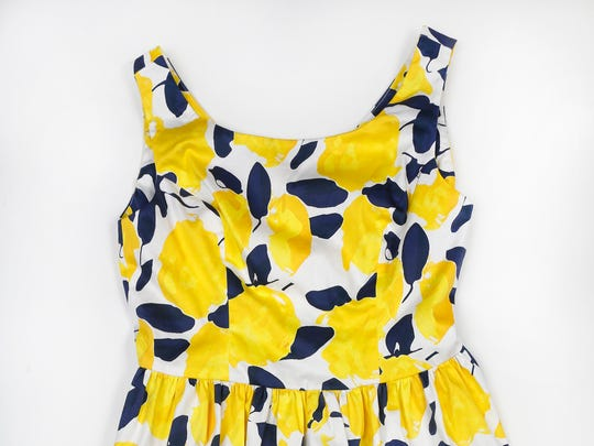 Crisp yellow and navy polished cotton teams up with a V-neck and full skirt for a great spring dress. $164 at Monkee's, 3624 Brownsboro Road
