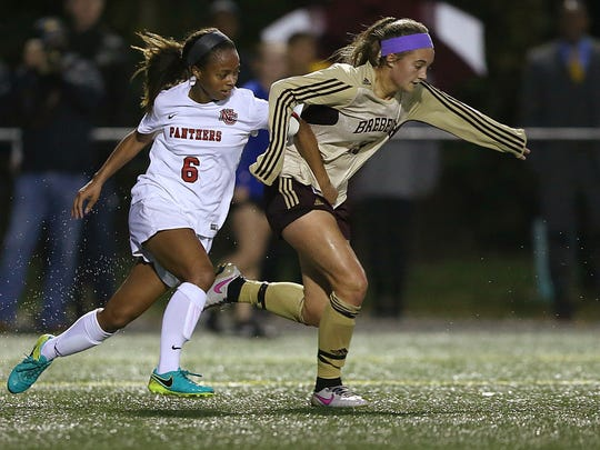 Brebeuf Jesuit's Braves Hallie Pearson (right) shown during soccer regionals against North Central, Oct. 12, 2016.