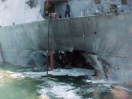 This Oct. 12, 2000, file image, provided by the U.S. Navy, shows damage sustained on the USS Cole after a terrorist bomb exploded during a refueling operation in the port of Aden, Yemen, on Oct. 12, 2000. Seventeen sailors were killed.