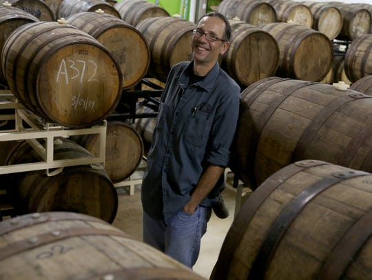 Ron Jeffries is surround by many barrels with ales