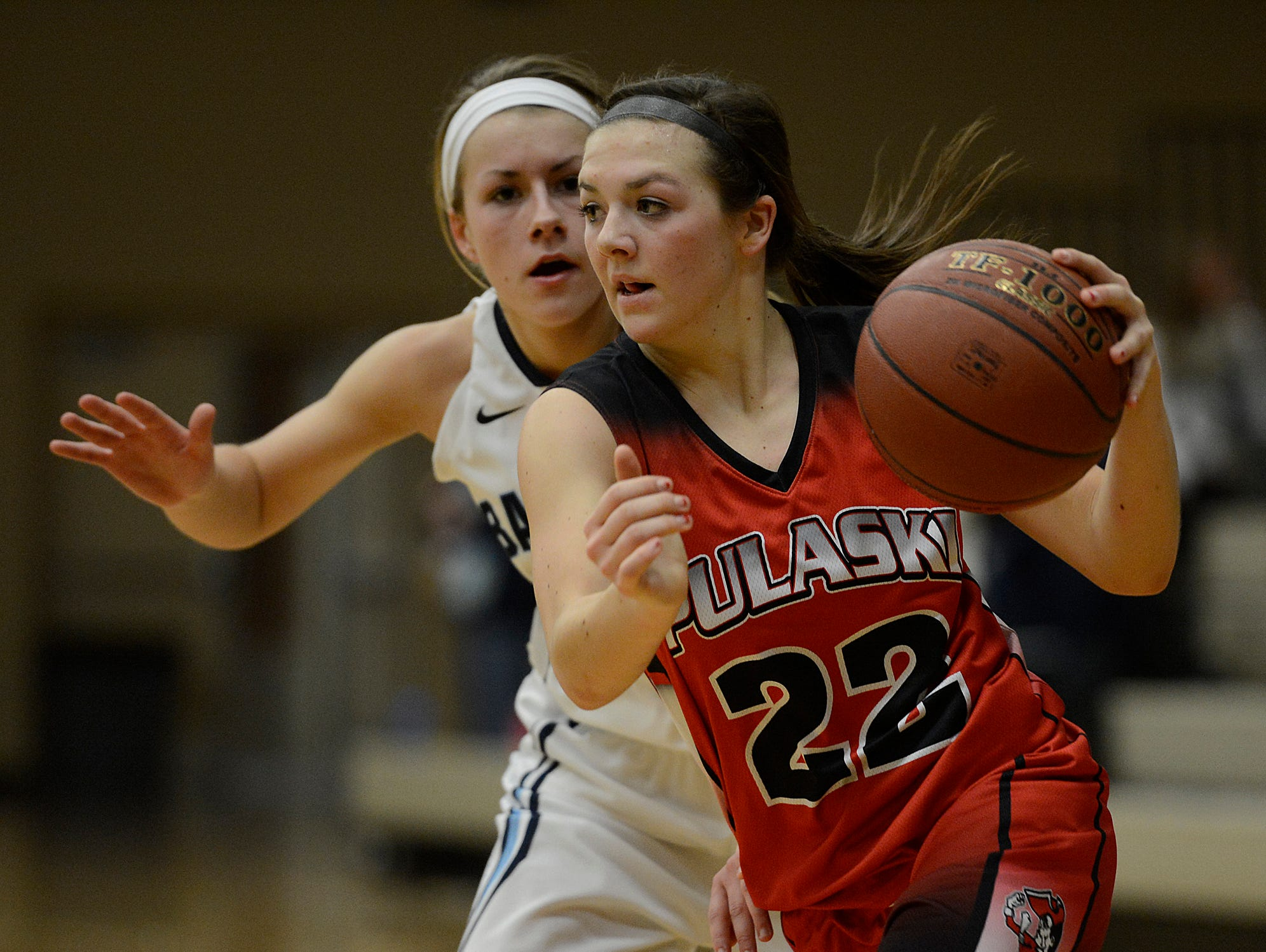 Pulaski's Mariah Szymanski (22) gets around Bay Port's Jamie Hebel during a Fox River Classic Conference game. Szymanski earned first-team all-state honors from the coaches.