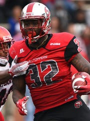 Western Kentucky running back D'Andre Ferby is one of 85 former Midstate high school football players who will play in college bowl games.