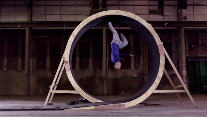 Free running stunt man successfully completes the human loop the loop.