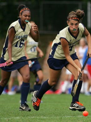 Ocean Twp. Spartans host Freehold Colonials for a varsity field hockey game, Tuesday, September 22, 2009. Freehold's midfielders, Emily Wold, right, drives the ball downfield, while Brit Jones, follows. STAFF PHOTO/MARY FRANK - OCEAN TWP. - SPORTS - #55414- 9/22/09.