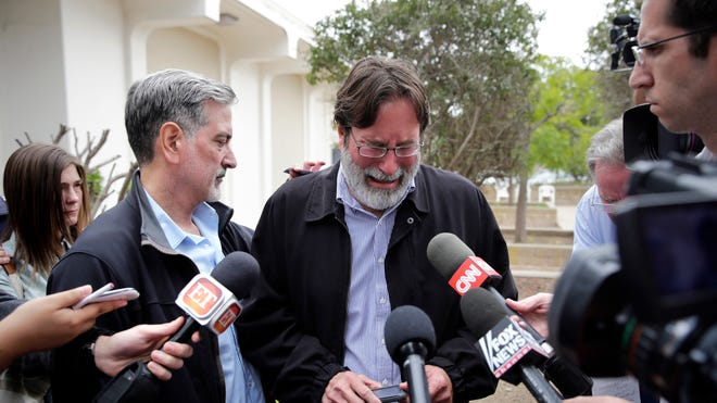 Richard Martinez, center, who says his son, Christopher Martinez, was killed in Friday night's mass shooting that took place in Isla Vista, Calif., is comforted by his brother, Alan, as he talks to media outside the Santa Barbara County Sheriff's Headquarters on Saturday, May 24, 2014, in Santa Barbara, Calif.
