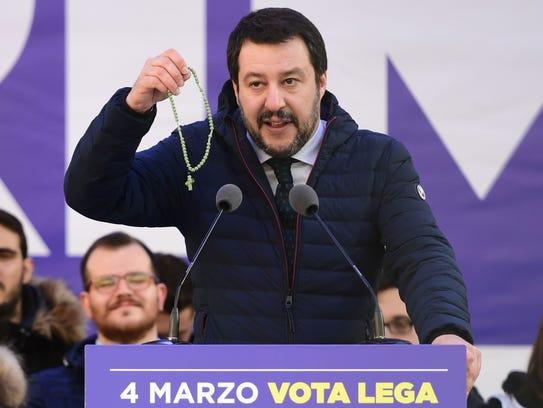 Lega Nord far right party leader Matteo Salvini holds