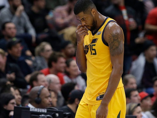 Utah Jazz forward/center Derrick Favors looks down as he walks to the bench during the second half of an NBA basketball game against the Chicago Bulls, Wednesday, Dec. 13, 2017, in Chicago. The Bulls won 103-100. (AP Photo/Nam Y. Huh)