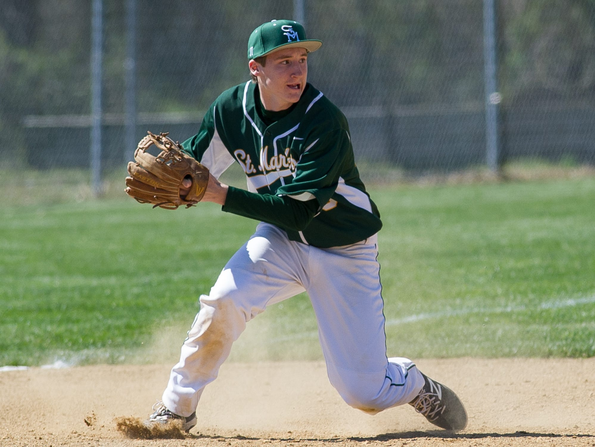 St. Mark's Christopher Ludman (20) makes a throw to second base for a out in the 3rd inning against Caesar Rodney.