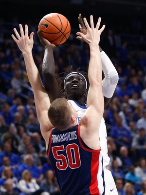 Wenyen Gabriel (32) of the Kentucky Wildcats shoots over Justas Furmanavicius (50) of the Mississippi Rebels at Rupp Arena in Lexington, Kentucky, on Wednesday, Feb. 28, 2018.