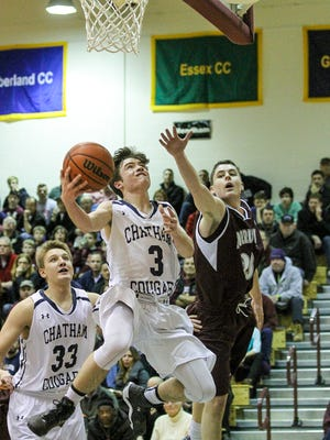 Chatham's Jack Rooney (3) goes up for a shot against Morristown's Kevin Hoehn (20) in their Morris County Tournament semifinal on Saturday at the County College of Morris.