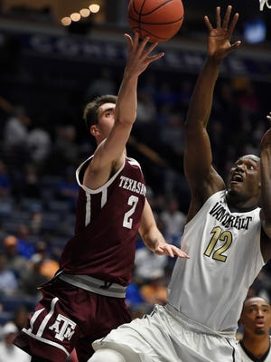 Former Texas A&M forward Eric Vila (2) goes to the basket against Auburn center Austin Wiley (50) and forward Danjel Purifoy (3), on Feb. 18, 2017, in College Station, Texas. Vila has signed with UTEP for the 2018-19 season.