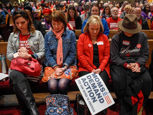 Members of the Moms Demand Action group start their Advocacy Day event with prayer at the Downtown Presbyterian Church in Nashville on March 7, 2018.