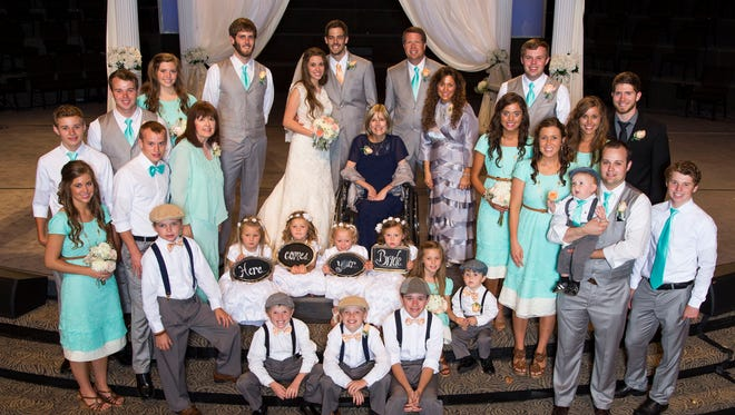 The Duggar and Dillard families.