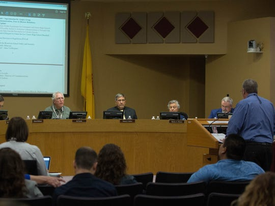 Ed Ellison, right, the chief financial officer for Las Cruces Public Schools, presenting the  LCPS budget update to the school board, Tuesday April 17, 2018.