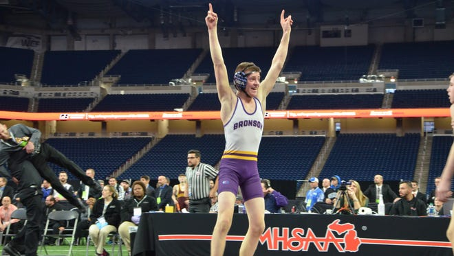 Bronson's Ben Modert celebrates winning a Division 4 state championship at 103 pounds during the MHSAA Individual Wrestling Finals at Ford Field in Detroit on March 3, 2018.