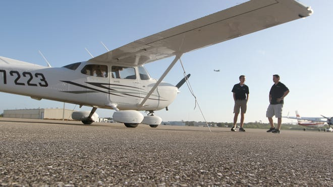 Jeffrey Wolf, left, and Chris Schoensee, use the Cessna 172SP to train students at Paragon Flight School in Fort Myers.
