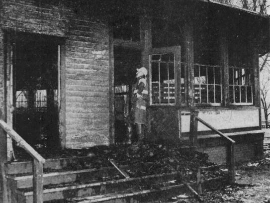 The burned-out shell of the Cason building in 1948.