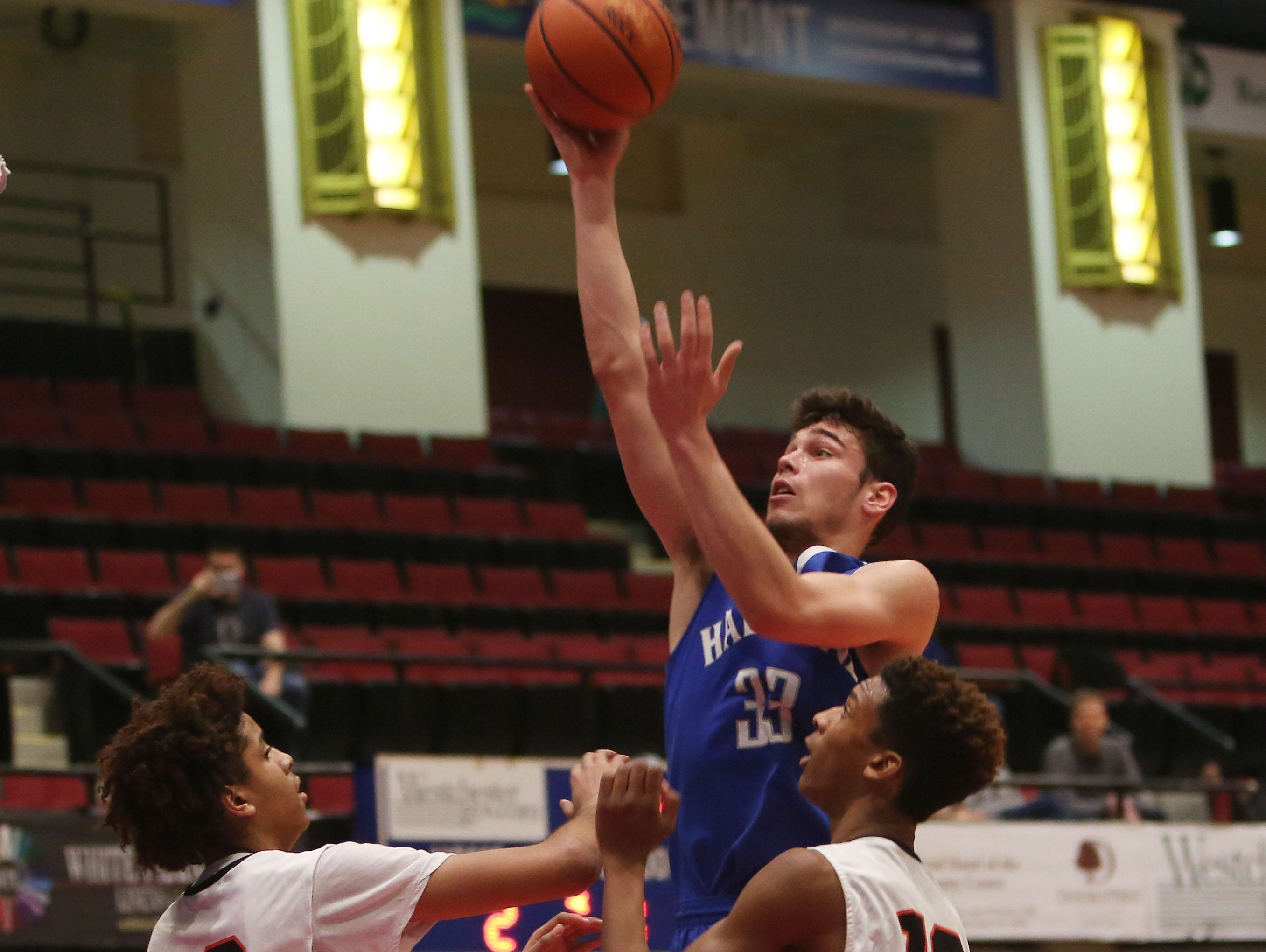 Haldane's Will Zuvic goes up for a shotover Tuckahoe's Bryan Murray (30) and Alexander Williams (13) during the first half of a boys Class C semifinal at the Westchester County Center in White Plains on Wednesday. Haldane won the game 44-34.