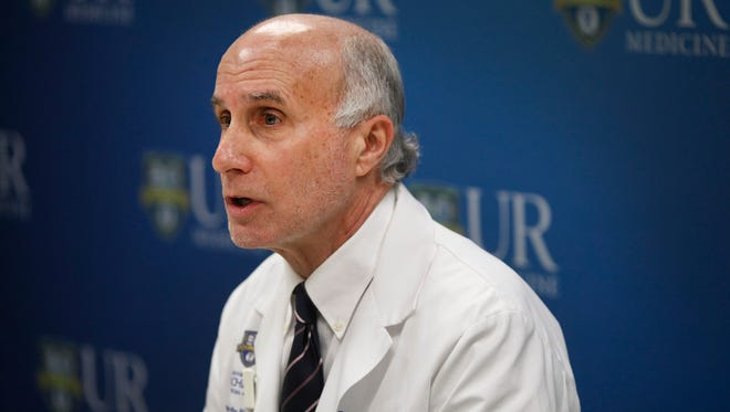 Dr. Paul Graman answers questions from the press at Strong Memorial Hospital about Ebola in light of a Webster nurse's voluntary quarantine after returning from Liberia.