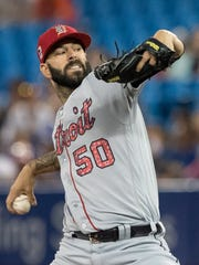 Mike Fiers pitches against the Blue Jays in the eighth inning Monday.