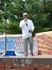 Imam Mika'il Stewart Saadiq leads chants with the crowd at Clark Park.