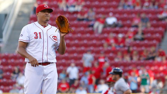 Reds starting pitcher Alfredo Simon stands at the mound