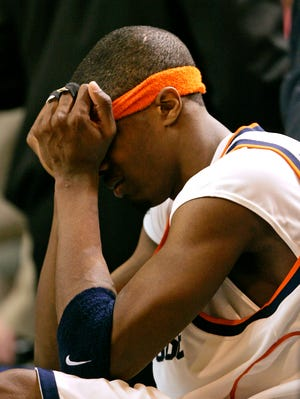 Syracuse's Hakim Warrick sulks on the bench as the Orange fall to Vermont in the first round of the 2005 NCAA tournament.