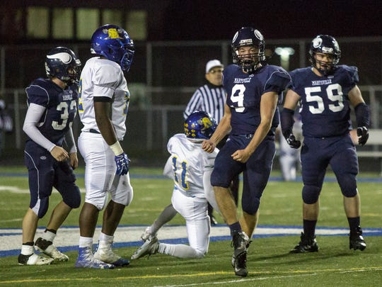 Marysville's Zane King celebrates a play during a football