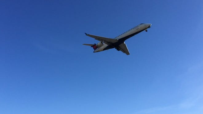A jet arrives at Greater Rochester International Airport on Nov. 25, one of the busiest holiday travel days of the year.