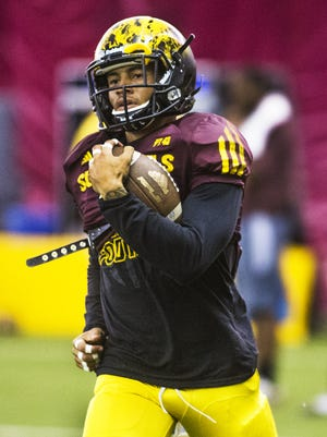 ASU's D.J. Foster runs during practice in the Verde Dickey Dome.