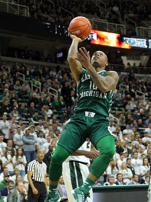 Eastern Michigan guard Willie Mangum (10) moves to the basket at Breslin Center on Monday.