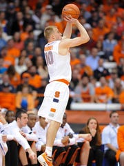 Syracuse guard Trevor Cooney, a Sanford graduate, unleashes a jumper in a game against Princeton at the Carrier Dome.