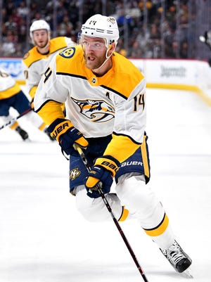 Nashville Predators defenseman Mattias Ekholm (14) moves the puck during the first period of game 4 in the first round NHL Stanley Cup Playoffs at the Pepsi Center, Wednesday, April 18, 2018, in Denver, Colo.
